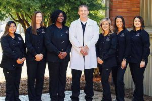 Claxton Smiles Youth Dentistry team photo outside